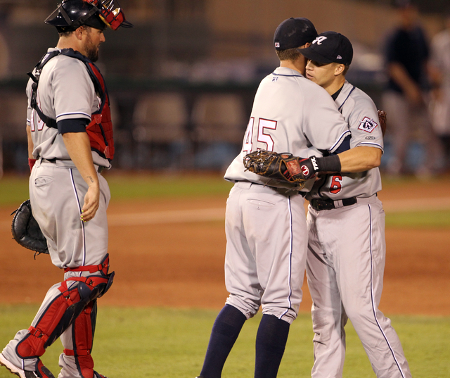 Reno Aces pitcher Andrew Chafin (45) is congratulated by first baseman Mike Jacobs (6) after beating the Las Vegas 51s 6-0 in Game 2 of their PCL Conference Championship Series at Cashman Field Th ...