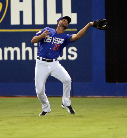 Las Vegas 51s center fielder Cory Vaughn catches a fly ball in the first inning of Game 1 of a PCL Conference Championship Series against the Reno Aces at Cashman Field Wednesday, Sept. 6, 2014. ( ...