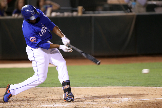 Las Vegas 51s left fielder Cesar Puello hits an RBI single against the  Reno Aces in the fifth inning of Game 1 of their PCL Conference Championship Series at Cashman Field Wednesday, Sept. 6, 201 ...