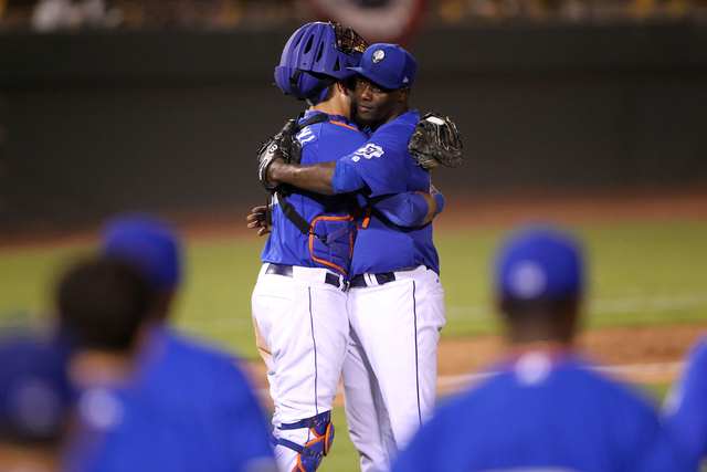Las Vegas 51s pitcher Gonzalez Germen, right, and catcher Kevin Plawecki embrace after beating the Reno Aces 5-4 in Game 1 of their PCL Conference Championship Series at Cashman Field Wednesday, S ...