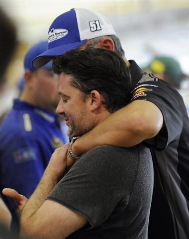 FILE - In this Aug. 30, 2014, file photo, Tony Stewart gets a hug from former crew chief Steve Addington in the garage during practice for the NASCAR Sprint Cup series auto race at Atlanta Motor S ...