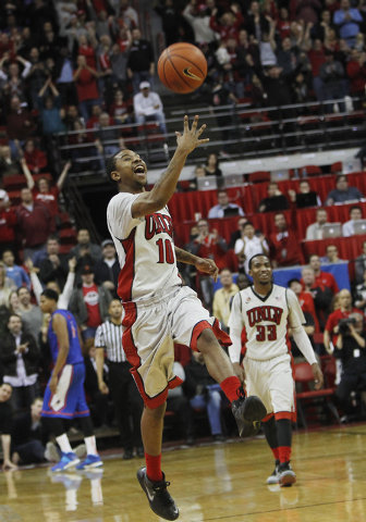 UNLV's Daquan Cook (10) tosses the ball in the air to celebrate his team's victory over Boise State at the Thomas & Mack Center in Las Vegas on Saturday, Feb. 1, 2014. Cook injured his knee and wi ...