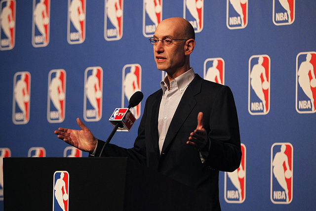 """NBA Commissioner Adam Silver speaks during a press conference at the Wynn Hotel and Casino in Las Vegas on Tuesday, July 15, 2014. Silver says his league will """"take a fresh look"""" at its domest ..."""