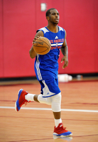Los Angeles Clippers' Chris Paul dribbles the ball down court during practice at NBA basketball training camp at the Mendenhall Center at UNLV on Tuesday, Sept. 30, 2014. (David Becker/Las Vegas R ...