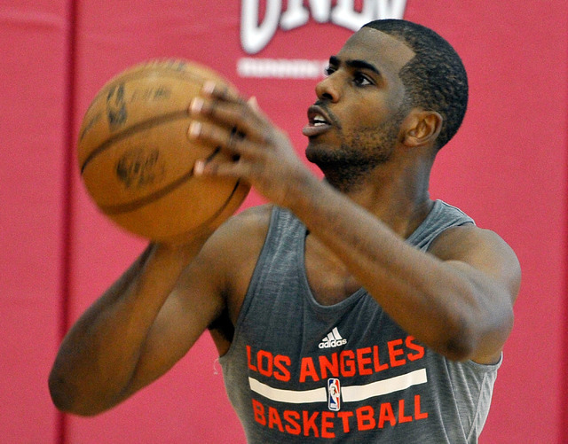 Los Angeles Clippers' Chris Paul shoots the ball during practice at NBA basketball training camp at the Mendenhall Center at UNLV on Tuesday, Sept. 30, 2014. (David Becker/Las Vegas Review-Journal)