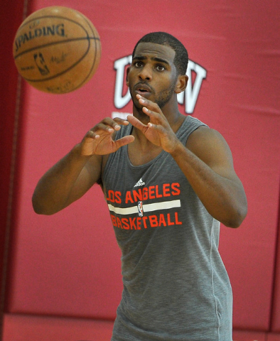 Los Angeles Clippers' Chris Paul passes the ball during practice at NBA basketball training camp at the Mendenhall Center at UNLV on Tuesday, Sept. 30, 2014. (David Becker/Las Vegas Review-Journal)