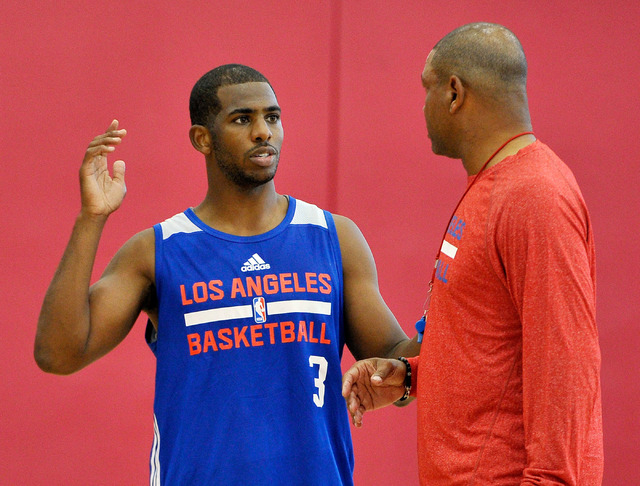 Los Angeles Clippers coach Doc Rivers, right, speaks with guard Chris Paul during practice at NBA basketball training camp at the Mendenhall Center at UNLV on Tuesday, Sept. 30, 2014. (David Becke ...