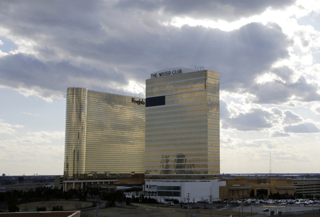 The Borgata Hotel Casino & Spa, left, and its sister property, The Water Club, right, are seen in Atlantic City, N.J., Wednesday, March 20, 2013. (AP Photo/Mel Evans)