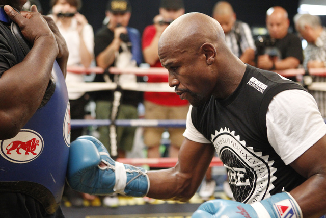Floyd Mayweather Jr. works out on the ring at his gym, Mayweather Boxing Club in Las Vegas, during a media event, Tuesday, Sept. 2, 2014. Mayweather hosted the event in anticipation of his Sept. 1 ...