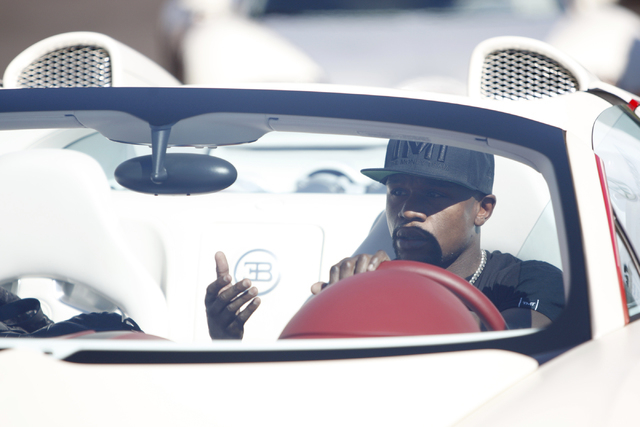 Floyd Mayweather Jr. drives up to his gym, Mayweather Boxing Club in Las Vegas, for a training session during a media event Tuesday, Sept. 2, 2014. Mayweather hosted the event in anticipation of h ...