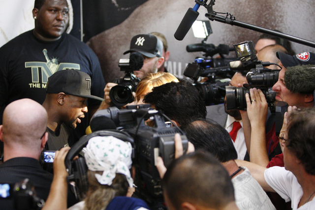 Floyd Mayweather Jr. is interviewed about his upcoming match at his gym, Mayweather Boxing Club in Las Vegas, during a media event Tuesday, Sept. 2, 2014. Mayweather hosted the event in anticipati ...
