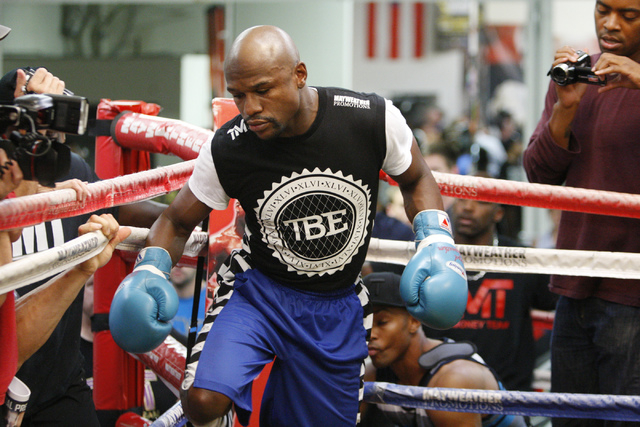 Floyd Mayweather Jr. enters the boxing ring at his gym, Mayweather Boxing Club in Las Vegas, during a media event Tuesday, Sept. 2, 2014. Mayweather hosted the event in anticipation of his Sept. 1 ...