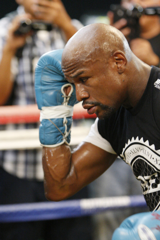 Floyd Mayweather Jr. works out on the boxing ring at his gym, Mayweather Boxing Club in Las Vegas, during a media event Tuesday, Sept. 2, 2014. Mayweather hosted the event in anticipation of his S ...