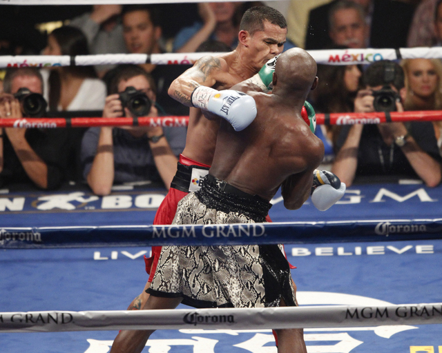 Floyd Mayweather Jr., right, connects a punch against Marcos Maidana in their boxing bout for the WBC and WBA Welterweight Title and WBC Super Welterweight Title at MGM Grand Garden Arena in Las V ...