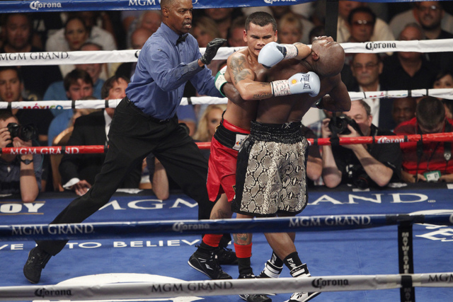 Marcos Maidana, left, and Floyd Mayweather Jr. grab each other in their boxing bout for the WBC and WBA Welterweight Title and WBC Super Welterweight Title at MGM Grand Garden Arena in Las Vegas S ...