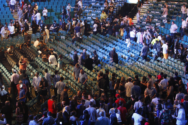 People wait for a disturbance to be resolved after the Marcos Maidana and Floyd Mayweather boxing bout at MGM Grand Garden Arena in Las Vegas Saturday, Sept. 13, 2014. (Erik Verduzco/Las Vegas Rev ...