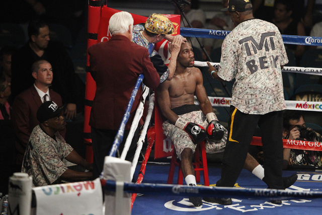 Mickey Bey rests at his corner between rounds in his fight against Miguel Vasquez for the IBF Lightweight Title at MGM Grand Garden Arena in Las Vegas Saturday, Sept. 13, 2014. Bey won the fight b ...
