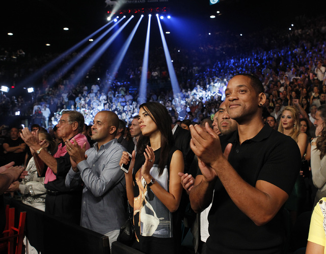 Actor Will Smith takes in the action before the Mayweather Maidana bout at the MGM Grand Garden Arena in Las Vegas on Saturday, Sept. 13, 2014. (Sam Morris/Las Vegas Review-Journal)