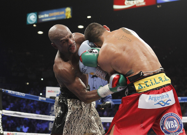 Floyd Mayweather Jr. connects with Marcos Maidana during their WBC/WBA welterweight title fight at the MGM Grand Garden Arena in Las Vegas on Saturday, Sept. 13, 2014. (Sam Morris/Las Vegas Review ...