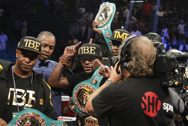 Floyd Mayweather Jr. celebrates after defeating Marcos Maidana for the WBC/WBA welterweight title fight at the MGM Grand Garden Arena in Las Vegas on Saturday, Sept. 13, 2014. (Sam Morris/Las Vega ...