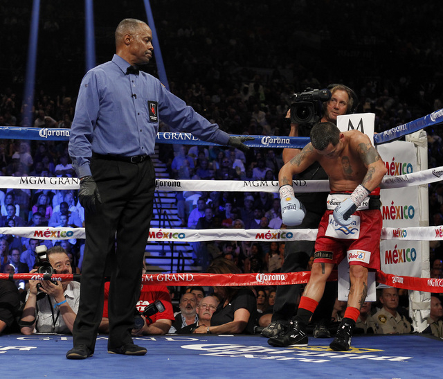 Marcos Maidana reacts to a low blow from  Floyd Mayweather Jr. during their WBC/WBA welterweight title fight at the MGM Grand Garden Arena in Las Vegas on Saturday, Sept. 13, 2014. (Sam Morris/Las ...