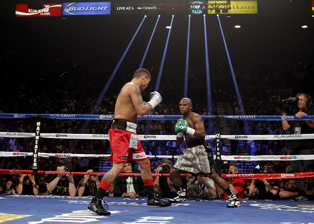 Floyd Mayweather Jr. dances around Marcos Maidana during their WBC/WBA welterweight title fight at the MGM Grand Garden Arena in Las Vegas on Saturday, Sept. 13, 2014. (Sam Morris/Las Vegas Review ...