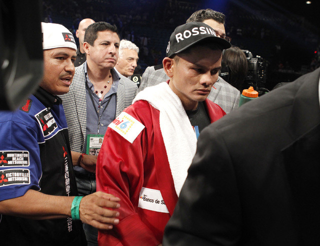Marcos Maidana reacts after losing to Floyd Mayweather Jr. for their WBC/WBA welterweight title fight at the MGM Grand Garden Arena in Las Vegas on Saturday, Sept. 13, 2014. (Sam Morris/Las Vegas  ...