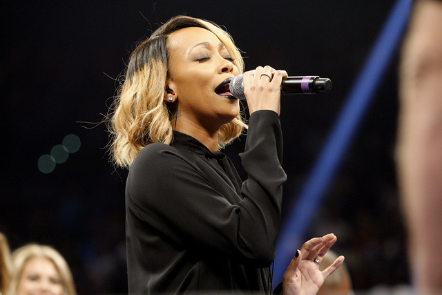 Monica Denise Brown sings the national anthem before the Marcos Maidana Floyd Mayweather Jr. WBC/WBA welterweight title fight at the MGM Grand Garden Arena in Las Vegas on Saturday, Sept. 13, 2014 ...