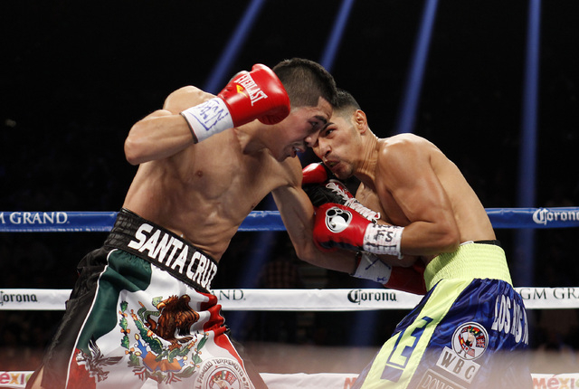 Leo Santa Cruz hits Manuel Roman during their WBC super bantamweight title fight at the MGM Grand Garden Arena in Las Vegas on Saturday, Sept. 13, 2014. (Sam Morris/Las Vegas Review-Journal)