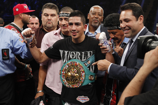 Leo Santa Cruz celebrates after defeating Manuel Roman in the second round of their WBC super bantamweight title fight at the MGM Grand Garden Arena in Las Vegas on Saturday, Sept. 13, 2014. (Sam  ...