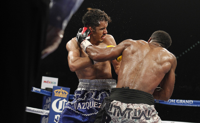Mickey Bey hits Miguel Vazquez during their IBF lightweight title fight at the MGM Grand Garden Arena in Las Vegas on Saturday, Sept. 13, 2014. (Sam Morris/Las Vegas Review-Journal)