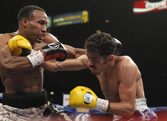Miguel Vazquez hits Mickey Bey during their IBF lightweight title fight at the MGM Grand Garden Arena in Las Vegas on Saturday, Sept. 13, 2014. (Sam Morris/Las Vegas Review-Journal)