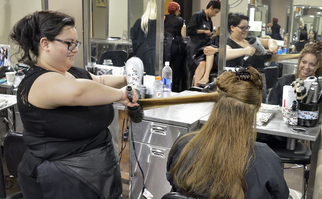 Student Juanita Seitz, left, does a blow out for customer Jessica Cervantes after a color change at the Aveda Institute Las Vegas at 4856 S. Eastern Ave. in Las Vegas on Thursday, Sept. 11, 2014.  ...