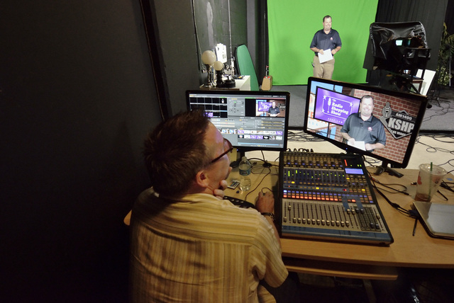 Scott Whitney, founder of the Vegas Video Co-op, left, mans the control deck while taping a spot for Brett Grant, owner of KSHP AM 1400, background, in the co-op studio at 101 Convention Center Dr ...