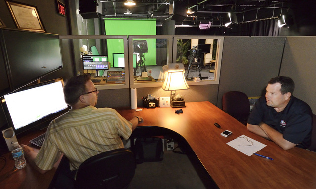 Scott Whitney, founder of the Vegas Video Co-op, left, talks about the shooting schedule before taping a spot for Brett Grant, owner of KSHP AM 1400, in the co-op studio at 101 Convention Center D ...
