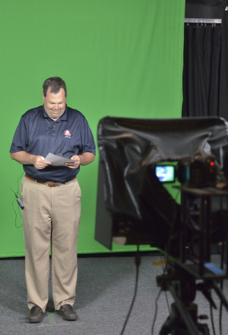 Brett Grant, owner of KSHP AM 1400, checks his notes before taping a spot in the Vegas Video Co-op studio at 101 Convention Center Drive in Las Vegas on Monday, Sept. 15, 2014. Grant is one of the ...