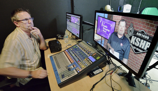 Scott Whitney, founder of the Vegas Video Co-op, left, checks the video feed while recording a spot for Brett Grant, owner of KSHP AM 1400, on screen, in the co-op studio at 101 Convention Center  ...
