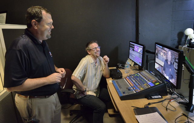 Scott Whitney, founder of the Vegas Video Co-op, right, and Brett Grant, owner of KSHP AM 1400, check the video for a spot shot for Grant's station in the co-op studio at 101 Convention Center Dri ...