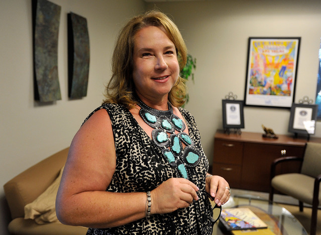 President Julie Gilday-Shaffer, of the JGS Group, stands in her Summerlin office on Tuesday, Sept. 2, 2014. Gilday-Shaffer started her career as a copy machine sales person and now runs her own co ...