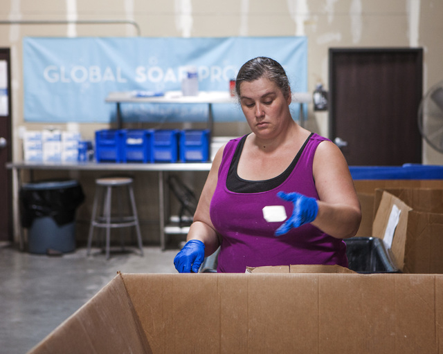 Carla Beauchamp tosses a used bar of soap after cleaning it at Global Soap Project, 3917 Lone Mountain Road, in North Las Vegas on Friday, Sept. 6, 2014. The nonprofit takes used bars of soap from ...