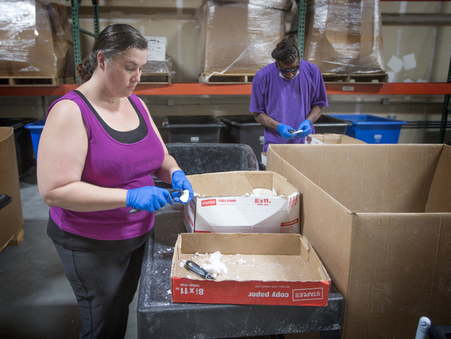 Carla Beauchamp, left, and Desi Coleman clean debris off soap at Global Soap Project at 3917 Lone Mountain Road in North Las Vegas on Friday, Sept. 6, 2014. The nonprofit takes used bars of soap f ...