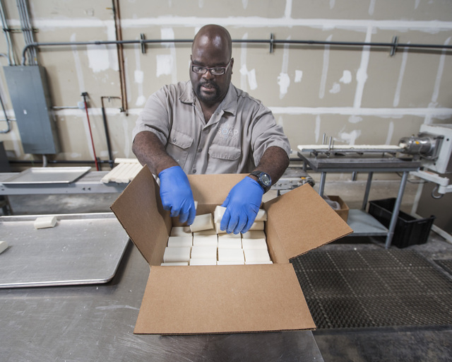 Plant manager Aaron Weatherly boxes new bars of soap at Global Soap Project at 3917 Lone Mountain Road in North Las Vegas as seen on Friday, Sept. 6, 2014. The nonprofit takes used bars of soap fr ...
