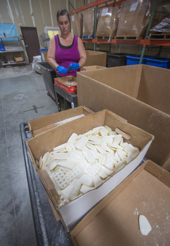 Carla Beauchamp cleans debris off soap at Global Soap Project at 3917 Lone Mountain Road in North Las Vegas on Friday, Sept. 6, 2014. The nonprofit takes used bars of soap from local resorts and r ...
