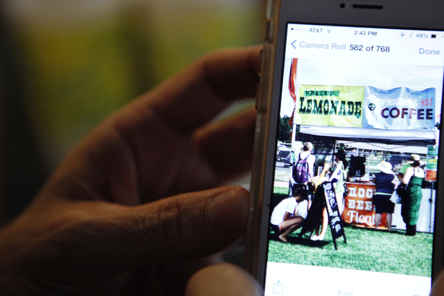 Rock Rocheleau shows a photo of his daughter's lemonade stand at their home in Henderson Saturday, Sept. 6, 2014. Rocheleau's three daughters started a lemonade business in March and have since ma ...