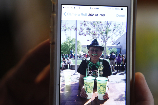 Rock Rocheleau shows a photo of his daughter's lemonade stand first customer at their home in Henderson Saturday, Sept. 6, 2014. Rocheleau's three daughters started a lemonade business in March an ...