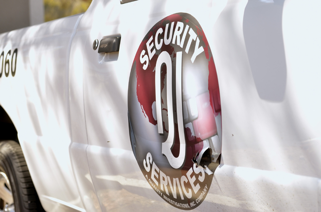 The QI Security Services logo is shown on the side of one of the company trucks in a lot at the company offices at 10 Commerce Center Drive in Henderson on Friday, Sept. 12, 2014. (Bill Hughes/Las ...