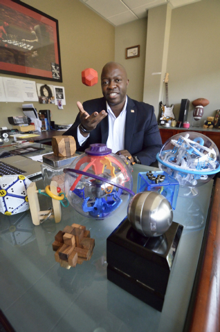 Xavier Peterson, president of QI Security Services, is shown with some of his puzzles in his office at 10 Commerce Center Drive in Henderson on Friday, Sept. 12, 2014. Solving puzzles is one of hi ...