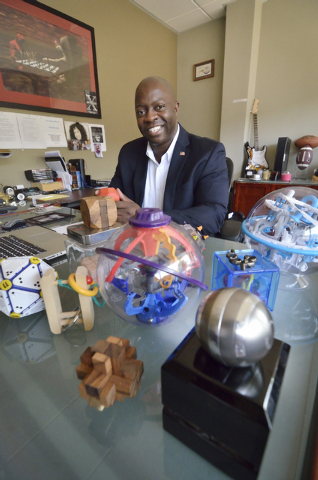 Xavier Peterson, president of QI Security Services, is shown with some of his puzzles at the company offices at 10 Commerce Center Drive in Henderson on Friday, Sept. 12, 2014. Solving puzzles is  ...