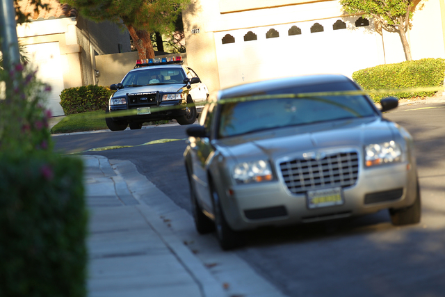 A Las Vegas police car sits at the end of the 1600 block of Broadmere Street on Monday, Sept. 22, 2014, where a fatal shooting occurred about 10 p.m. Sunday, Sept.21, near Hualapai Way and Charles ...