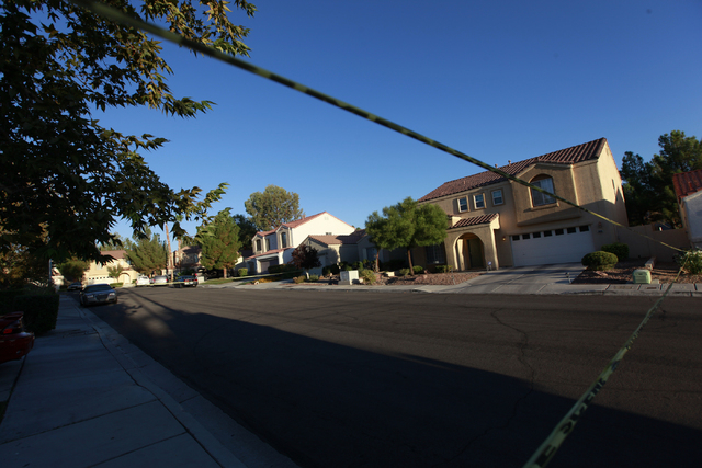 Crime scene tape blocks Garamound Avenue near the 1600 block of Broadmere Street on Monday, Sept. 22, 2014, where a fatal shooting occurred about 10 p.m. Sunday, Sept.21, near Hualapai Way and Cha ...